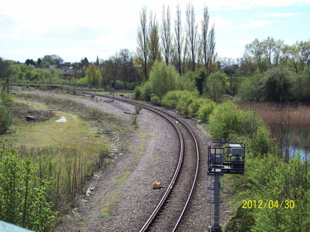 March station left centre with Peterborough to Ely line running from right to left. Line from Wisbech and Whitemoor Yard in foreground.